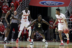"20 March 2017:  DJ Clayton(2) works the outside assited by Daouda ""David"" Ndiaye (4) against Tank Efianayi and Chad Brown during a College NIT (National Invitational Tournament) 2nd round mens basketball game between the UCF (University of Central Florida) Knights and Illinois State Redbirds in  Redbird Arena, Normal IL"