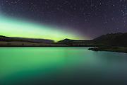 Northern light reflection in mountain water   Nordlys som reflekterer i et fjellvann
