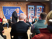 30 JANUARY 2020 - NEWTON, IOWA: Former Vice President JOE BIDEN, (seated, back to camera) listens to former Iowa Governor TOM VILSACK talk about why Biden should be president during a campaign event in Newtown. About 150 people came to listen to Vice President Biden talk about his reasons for running for President. Biden used the event to outline the differences between himself and President Trump. Iowa hosts the first event of the presidential election cycle. The Iowa Caucuses are Feb. 3, 2020.           PHOTO BY JACK KURTZ