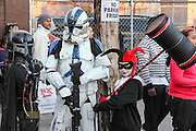 Oct. 25, 2013 - Bronx, NY. Boba Fett and a Stormtrooper from Star Wars wait with Harley Quinn from Batman for the start of the 28th Annual South Bronx Halloween Parade in Hunts Point. 10/25/2013 Photo by Nicholas Wells / CUNY Photo Wire