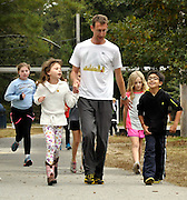 Sagamore Hills Elementary School parent volunteers help students first stretch out, then run behind the school during their first Running Club event on Monday, Oct. 28, 2013, in Atlanta.  (David Tulis/dtulis@gmail.com)