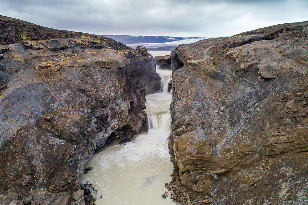 Iceland - Nýifoss waterfall from lake Hagavatna fed by glacier Langjokull