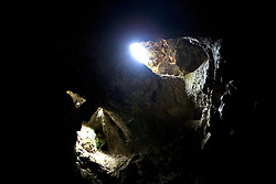 Light enters through a shaft in the Sentinel Cave, one of hundreds of lava tube caves in Lava Beds National Memorial, California