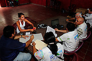 A teenage girl listens to doctors and consultants from the 'Nefrolempa' health project, as they explain the results of her medical tests as part of a series of medical investigations carried out by the 'Nefrolempa' health team into the high incidence of chronic renal failure in the region.<br /> <br /> Community of Ciudad Romero, Bajo Lempa, El Salvador. 2011.<br /> The 'Nefrolempa' research project is a collaboration between the El Salvador Ministry of Health, the Nephrology Institute of Cuba's Ministry for Public Health and the United Bajo Lempa Committee Association. The aim of the project is to investigate the reasons for the high levels of Chronic Kidney Disease (CKD) suffered by the communities within the Bajo Lempa region. It is exploring whether the use of agrochemicals might be a factor in the prevalence of the disease.