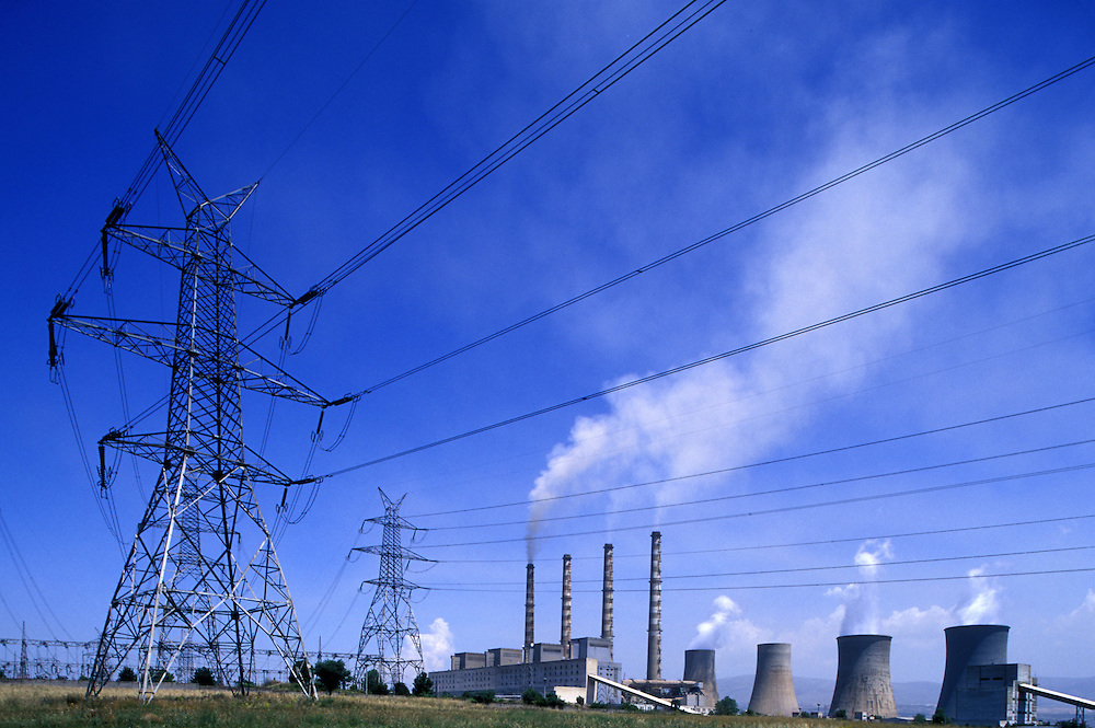 Europe, Greece, Macedonia, Kozani, Smoke billows from stacks of S.E.S. of Kardia coal powered electrical generating station