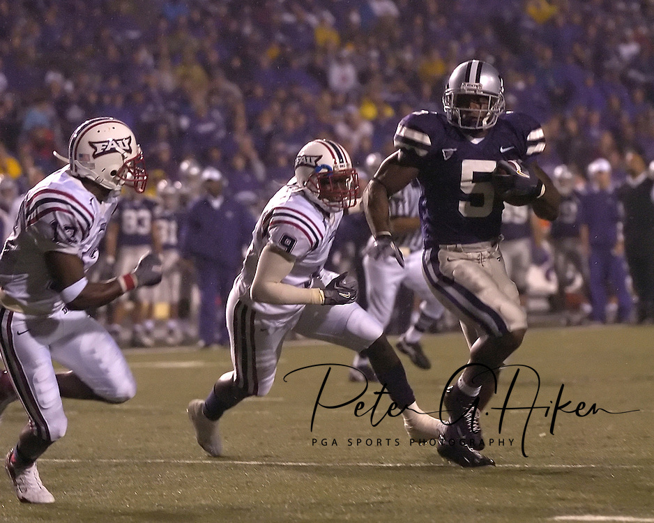 Kansas State running back Thomas Clayton (5) races past Florida Atlantic defenders Taheem Acevedo (9) and Rickey Bethel (13) for a two yard touchdown run in the second half, at Bill Snyder Family Stadium in Manhattan, Kansas, September 9, 2006.  The Wildcats beat the Owls 45-0.