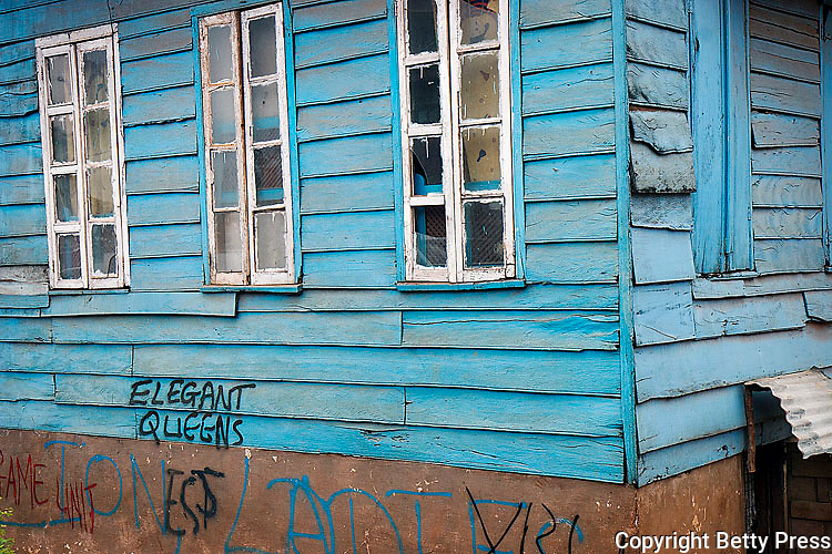 Elequent Queens, graffiti, on an old wooden house in downtown Freetown.