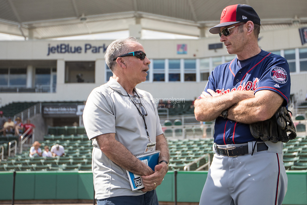 FORT MYERS, FL- FEBRUARY 25: Paul Molitor #4 of the Minnesota Twins talks with Tim Kurkjian of ESPN against the Boston Red Sox on February 25, 2017 at JetBlue Park in Fort Myers, Florida. (Photo by Brace Hemmelgarn) *** Local Caption *** Paul Molitor;Tim Kurkjian