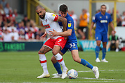AFC Wimbledon midfielder Callum Reilly (33) battles for possession with Rotherham United Kyle Vassell (7) during the EFL Sky Bet League 1 match between AFC Wimbledon and Rotherham United at the Cherry Red Records Stadium, Kingston, England on 3 August 2019.