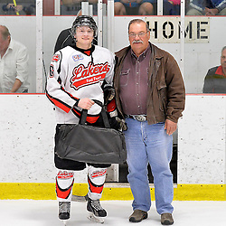 """FORT FRANCES, ON - Apr 30, 2015 : Central Canadian Junior """"A"""" Championship, game action between the Dryden GM Ice Dogs and the Fort Frances Lakers, game six of the Dudley Hewitt Cup. Lucas DeBenedet #16 of the Fort Frances Lakers receives the player of the game award.<br /> (Photo by Shawn Muir / OJHL Images)"""