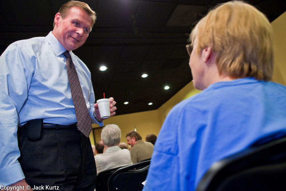 July 14 - PEORIA, AZ: JD HAYWORTH, a former Republican Congressman from Arizona, talks to supporters before addressing a Tea Party meeting in Peoria, AZ. Hayworth spoke to the Tea Party gathering in a hotel meeting room in Peoria. Hayworth, an ultra conservative, is running to the right of long serving US Sen John McCain in the Arizona Republican US Senate primary. He has painted McCain as a moderate to liberal Senator in the mold John Kerry (D-MA).          Photo by Jack Kurtz