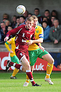 Bristol - Saturday November 7th, 2009: Grant Holt of Norwich City and Ollie Price of Paulton Rovers during the FA Cup 1st round match at Paulton. (Pic by Alex Broadway/Focus Images)..
