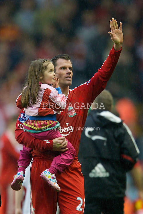 LIVERPOOL, ENGLAND - Sunday, May 4, 2008: Liverpool's Jamie Carragher with his daughter during the players' lap-of-honour following the final Premiership match of the season at Anfield. (Photo by David Rawcliffe/Propaganda)