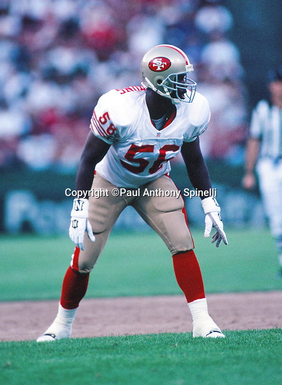 An unidentified San Francisco 49ers linebacker (56) gets set for the snap during the NFL preseason football game against the Carolina Panthers on Aug. 19, 1995 in San Francisco. The 49ers won the game 17-10. (©Paul Anthony Spinelli)