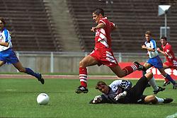 BERLIN, GERMANY - Sunday, August 7, 1994: Liverpool's Jamie Redknapp skips past Hertha BSC Berlin's goalkeeper Marco Sejna during a preseason friendly between Hertha BSC Berlin and Liverpool FC at the Olympiastadion. Liverpool won 3-0. (Pic by David Rawcliffe/Propaganda)
