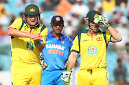Shane Watson of Australia gestures to the dugout as MS Dhoni (capt & wk) of India and Phillip Hughes of Australia look on during the 2nd One Day International (ODI) match in the Star Sports Series between India and Australia held at the Sawai Mansingh Stadium in Jaipur on the 16th October 2013<br /> <br /> Photo by Ron Gaunt-BCCI-SPORTZPICS<br /> <br /> Use of this image is subject to the terms and conditions as outlined by the BCCI. These terms can be found by following this link:<br /> <br /> http://sportzpics.photoshelter.com/gallery/BCCI-Image-terms-and-conditions/G00004IIt7eWyCv4/C0000ubZaQCkIRgQ
