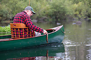 Angler Matson Holbrook lands a native Brook trout from the Upper Brule River near Lake Nebagamon, Wisconsin, in a 1895 Lucius guide canoe meticulously restored over the course of two years by Brule Guide Damian Wilmot.