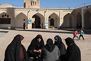 women inside the Masjed-e Jameh mosque.<br /> Built for Sayyed Roknaddin in the 15th century, the mosque is built on 12th-century foundations over a former fire temple. This this magnificent building is graced with a tiled entrance portal (one of the tallest in Iran), flanked by two 48m-high minarets and adorned with inscriptions from the 15th century. The exquisite mosaics on the dome and mihrab, and the tiles above the main western entrance to the courtyard are masterpieces of calligraphy, evoking sacred names in infinitely complex patterns.