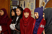 Young muslim women wearing traditional modest hijab clothing at the East London Mosque, London