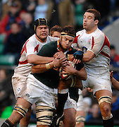 Twickenham, GREAT BRITAIN, left Tom PALMER and Right Joe WORSLEY, hold up SA's Danie ROSSOUW, during the, Investec 2006 Rugby Challenge, England vs South Africa, at Twickenham Stadium, ENGLAND on Sat 25.11.2006. [Photo, Peter Spurrier/Intersport-images]