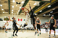 Vermont's Trae Bell-Haynes leaps over Dartmouth's Ike Nqwudo (2) for a lay up during the men's basketball game between the Dartmouth Big Green and the Vermont Catamounts at Patrick Gym on Wednesday December 7, 2016 in Burlington (BRIAN JENKINS/for the FREE PRESS)