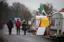 © Licensed to London News Pictures . 24/01/2014 . Barton Moss Road , Manchester , UK . Site of a protest camp on Barton Moss Road where anti-fracking demonstrators are based on an access road leading to an iGas fracking site as today (24th January 2014) Greater Manchester Police announce two further arrests from the ongoing protest after reporting that a security guard was threatened and assaulted on Barton Moss Road on Monday (20th January 2014) . Photo credit : Joel Goodman/LNP