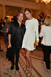 CHRISTOPHER KANE and AMBER LE BON at a party hosed by the US Ambassador to the UK Matthew Barzun, his wife Brooke Barzun and editor of UK Vogue Alexandra Shulman in association with J Crew to celebrate London Fashion Week held at Winfield House, Regent's Park, London on 16th September 2014.
