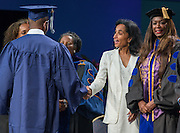Alison Leland congratulates graduates during the first ever graduation for Mickey Leland College Preparatory Academy, May 27, 2015.
