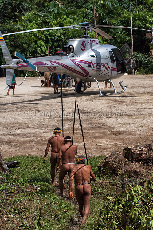 Huaorani Indians. Gabaro Community. Yasuni National Park.<br /> Amazon rainforest, ECUADOR.  South America<br /> This Indian tribe were basically uncontacted until 1956 when missionaries from the Summer Institute of Linguistics made contact with them. However there are still some groups from the tribe that remain uncontacted.  They are known as the Tagaeri. Traditionally these Indians were very hostile and killed many people who tried to enter into their territory. Their territory is in the Yasuni National Park which is now also being exploited for oil.