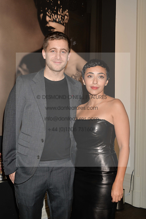 MASHAEL AL-RUSHAID and TYRONE WOOD at a private view of photographs by Marc Lagrange at Heist, 43 Linden Gardens, London on 2nd October 2014.