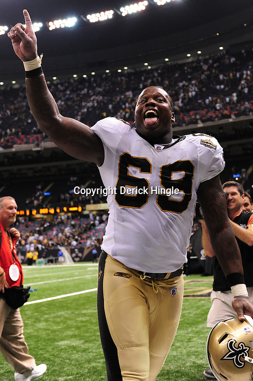 September 9, 2010; New Orleans, LA, USA; New Orleans Saints defensive lineman Anthony Hargrove (69) celebrates following the NFL Kickoff season opener at the Louisiana Superdome. The New Orleans Saints defeated the Minnesota Vikings 14-9.  Mandatory Credit: Derick E. Hingle