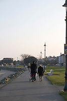 People walking at Sandymount Strand in Dublin Ireland on a winters evening