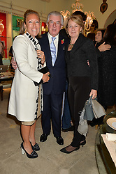 Left to right, ALISA SWIDLER and LORD & LADY MAGAN at the London debut of Nest - an organisation to promote peace and prosperity in partnership with artisans worldwide, held at Thomas Goode & Co, South Audley Street, London on 4th November 2014.