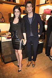 JULIA RESTOIN-ROITFELD and ROBERT KONJIC at the opening of Loewe's new boutique at 125 Mount Street, London on 23rd March 2011.