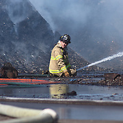 04/08/12 Wilmington Del. Wilmington fire fighters battle flames from a fire at a Mulch facility at the port of Wilmington Sunday, April. 08, 2012 in Wilmington Del...Special to The News Journal/SAQUAN STIMPSON