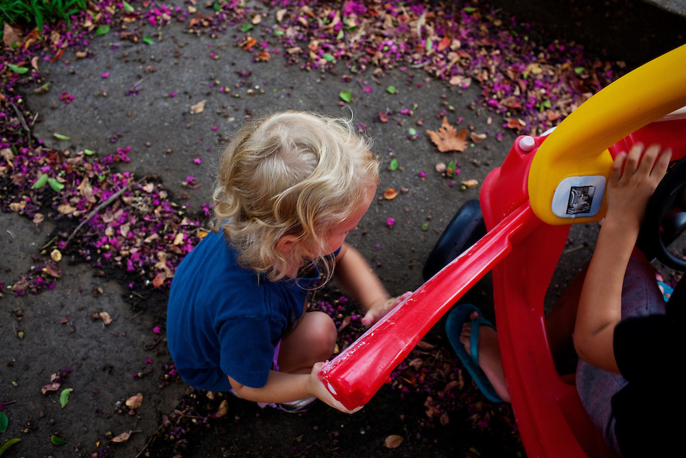 Madelyn Avery Eich, 2, plays with her friend Beckham in front of her house on the afternoon of Friday, September 3, 2010 in Norfolk, Virginia.
