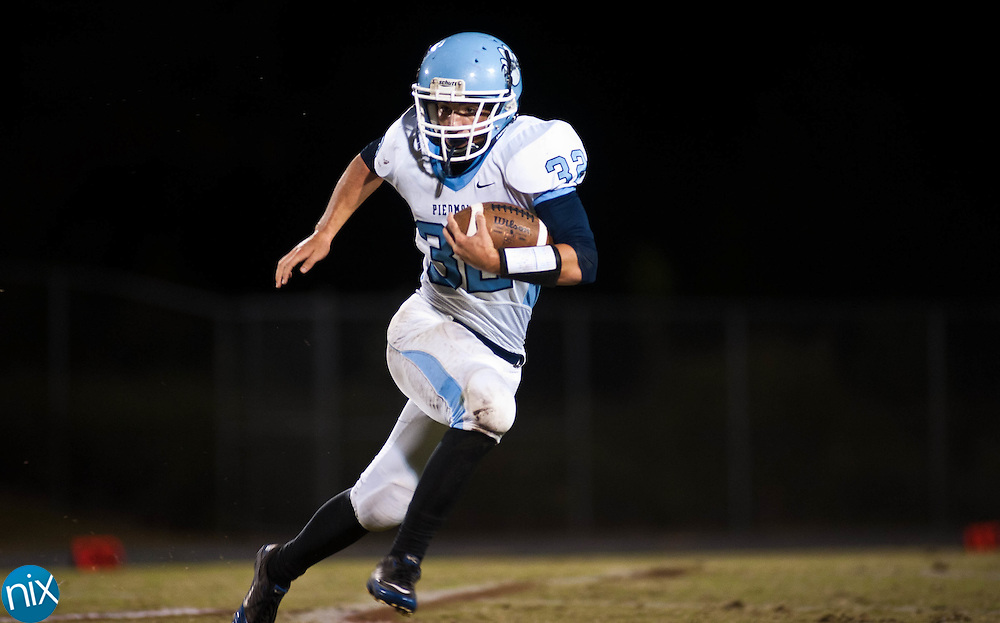 Piedmont's Brandon Gentry carries the ball against Jay M. Robinson Monday night in Concord. The game was originally set for Sept. 2, but was postponed due to weather. (Photo by James Nix)
