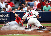ATLANTA, GA - SEPTEMBER 15:  Shortstop Steve Lombardozzi #1 of the Washington Nationals slides into home plate while catcher Brian McCann #16 of the Atlanta Braves tags him without the ball during the game at Turner Field on September 15, 2012 in Atlanta, Georgia.  (Photo by Mike Zarrilli/Getty Images)