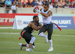 July 19, 2018 - Houston, TX, U.S. - HOUSTON, TX - JULY 19:  Godspeed defensive back Josh Wilson (26) reaches to tug a flag from Fighting Cancer center Robert Myers (9) during the American Flag Football League Ultimate Final game between the Fighting Cancer and Godspeed on July 19, 2018 at BBVA Compass Stadium in Houston, Texas.  (Photo by Leslie Plaza Johnson/Icon Sportswire) (Credit Image: © Leslie Plaza Johnson/Icon SMI via ZUMA Press)