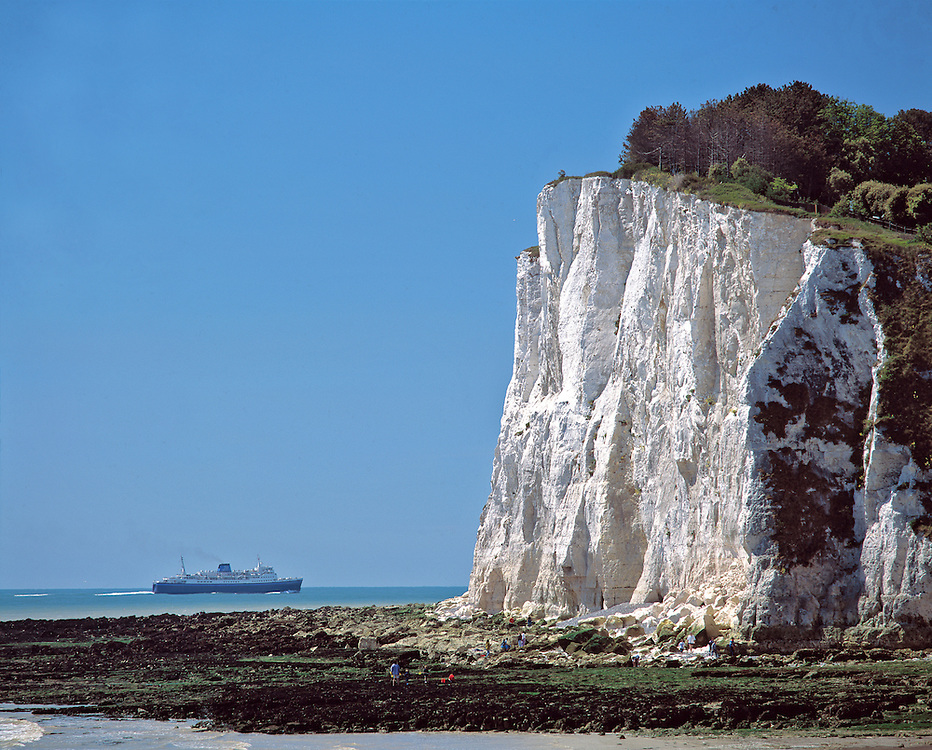 A passenger ship sails by the White Cliffs of Dover in County Kent, England.