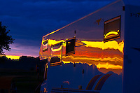 A camper at sunset, Cedar Pass campground, Badlands National Park, South Dakota USA