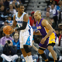 December 29, 2010; New Orleans, LA, USA; New Orleans Hornets point guard Chris Paul (3) is guarded by Los Angeles Lakers point guard Derek Fisher (2) during the first half at the New Orleans Arena.   Mandatory Credit: Derick E. Hingle