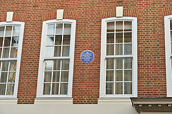 The Blue Plaque celebrating Sir Thomas Sopwith at 46 Green Street, Mayfair, London photographed on 28th May 2015.