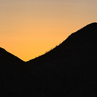Beautiful sunset behind the mountains of the Hells Gate Wilderness Area, near Phoenix, Arizona
