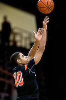 JEROME A. POLLOS/Press..Post Falls High's Shawn Reid puts up a three-point shot in the first half of Friday's game against Madison High during the state 5A boys basketball tournament at the Idaho Center in Nampa.