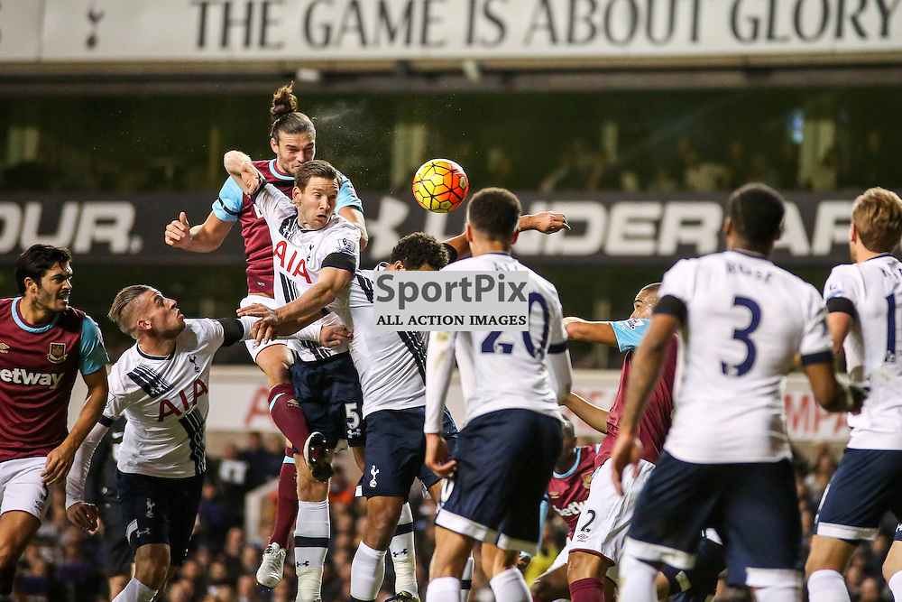 Andy Carroll heads with competition from  Jan Vertonghen During Tottenham Hotspur vs West Ham United on Sunday the 22nd November 2015.