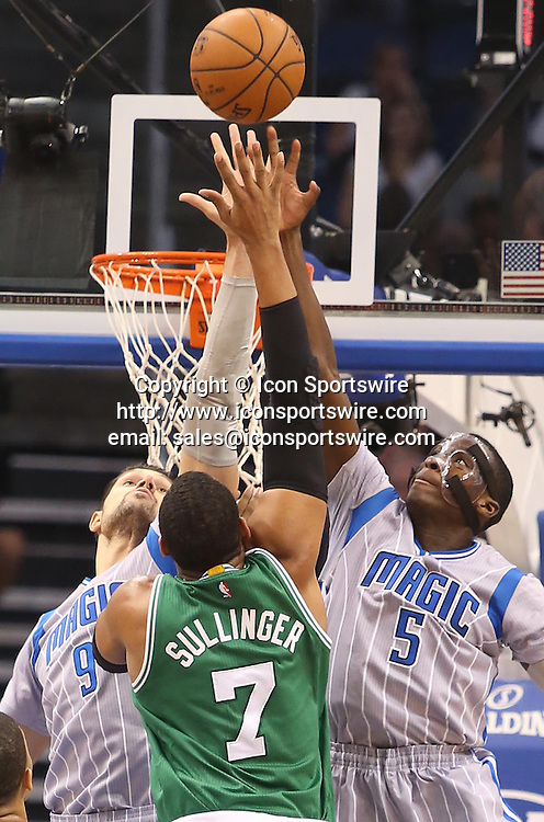 Dec. 23, 2014 - Orlando, FL, USA - The Orlando Magic's Nikola Vucevic (9) and Victor Oladipo (5) block the shot of the Boston Celtics' Jared Sullinger (7) at the Amway Center in Orlando, Fla., on Tuesday, Dec. 23, 2014