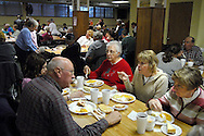 25 MARCH 2011 -- LEMAY, Mo. -- Diners fill the cafeteria at St. Andrew Catholic Church in Lemay, Mo. for the weekly fish fry onFriday, March 25, 2011. Volunteers served more than 600 meals Friday and ran out of the parish's signature macaroni and cheese, said Karen Wood, one of the parishioners who helps organize the fish fry. Image © copyright 2011 Sid Hastings.