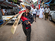 24 OCTOBER 2015 - YANGON, MYANMAR: Shia men walk in a procession during Ashura observances at Mogul Mosque in Yangon. Ashura commemorates the death of Hussein ibn Ali, the grandson of the Prophet Muhammed, in the 7th century. Hussein ibn Ali is considered by Shia Muslims to be the third imam and the rightful successor of Muhammed. He was killed at the Battle of Karbala in 610 CE on the 10th day of Muharram, the first month of the Islamic calendar. According to Myanmar government statistics, only about 4% of the population is Muslim. Many Muslims have fled Myanmar in recent years because of violence directed against Burmese Muslims by Buddhist nationalists.     PHOTO BY JACK KURTZ