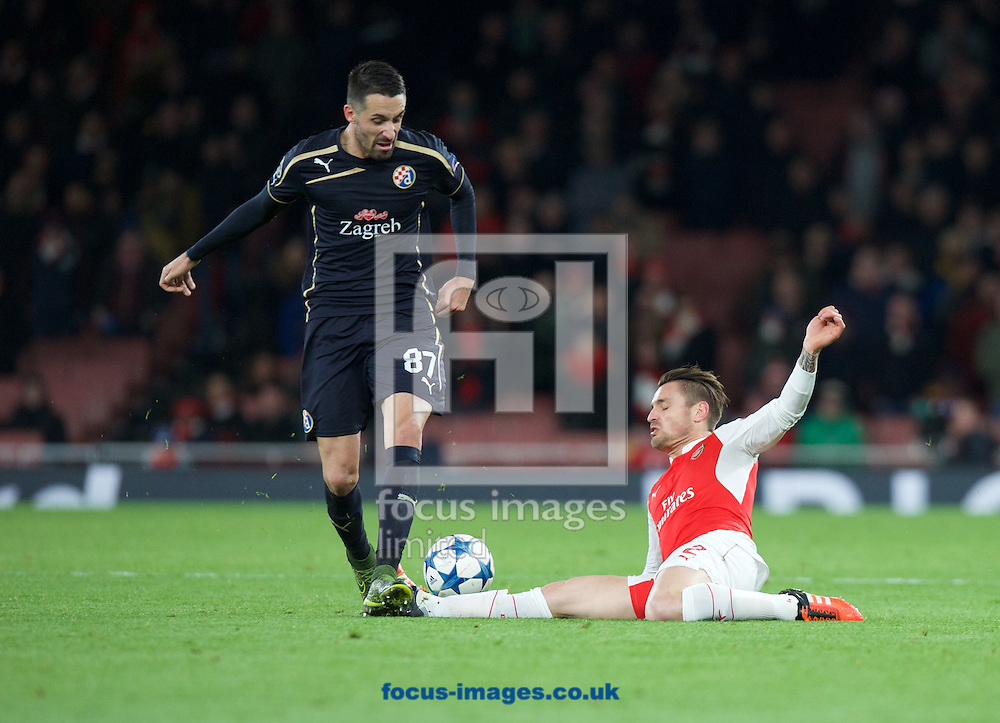 Mathieu Debuchy of Arsenal goes in with a sliding tackle on Jeremy Taravel of Dinamo Zagreb during the UEFA Champions League match at the Emirates Stadium, London<br /> Picture by Alan Stanford/Focus Images Ltd +44 7915 056117<br /> 24/11/2015